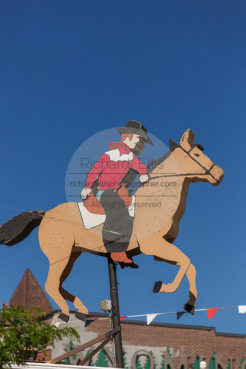 A cowboy riding horseback displayed in front of the Railroad Depot Museum July 23, 2015 in Cheyenne, Wyoming.