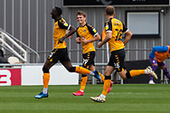 Newport County's Saikou Janneh (20) celebrates scoring the opening goal with his team mates during the EFL Sky Bet League 2 match between Newport County and Tranmere Rovers at Rodney Parade, Newport, Wales on 17 October 2020.
