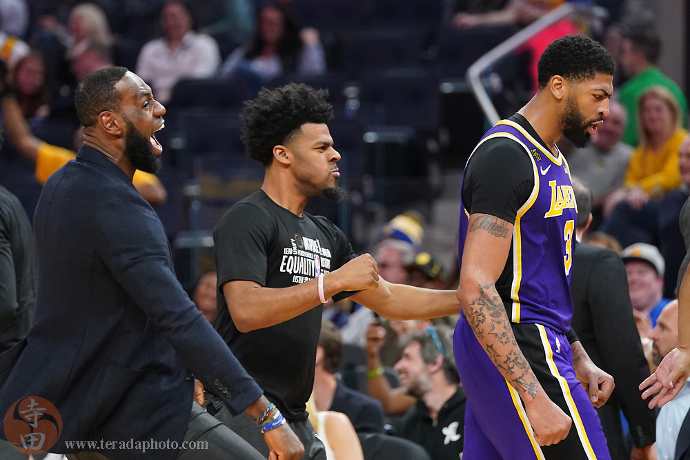 February 27, 2020; San Francisco, California, USA; Los Angeles Lakers forward LeBron James (23), guard Quinn Cook (28), and forward Anthony Davis (3) celebrate against the Golden State Warriors during the third quarter at Chase Center.