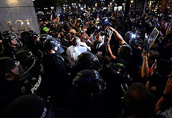Protesters confront police officers in riot gear near Trade and Tryon Streets in Charlotte, NC, USA, on Thursday, September 22, 2016, as demonstrations continue following the shooting death of Keith Scott by police earlier in the week. Photo by Jeff Siner/Charlotte Observer/TNS/ABACAPRESS.COM