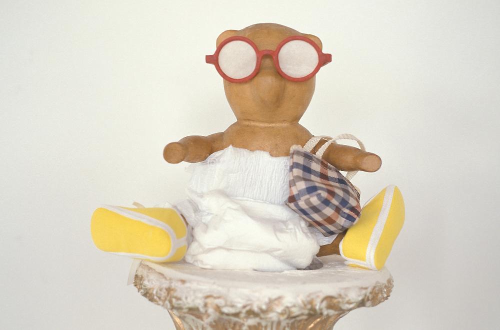 wooden bear in funny attire