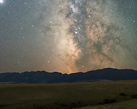 The core of the milky way galaxy was shining brilliantly as it set behind the Bighorn Mountains. This is a 2-image composite, with a 10 minute tracked exposure of the sky, and then another for the foreground.