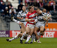 Photo: Jed Wee.<br /> Hull v Wigan Warriors. Engage Super League. 30/04/2006.<br /> <br /> Hull's Richard Horne (R) is tackled by Wigan's Oliver Wilkes.