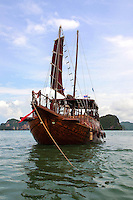 Ayodthya Boat on Phang Nga Bay - Ao Phang nga in the Andaman Sea between the island of Phuket and the mainland of the  of southern Thailand. The bay has been protected as the Ao Phang Nga National Park. Limestone cliffs, cave systems and archaeological sites are found all around Phang Nga Bay. The most famous of the many islands in the bay is James Bond Island, a  limestone rock in the sea, which featured in the movie The Man with the Golden Gun.