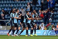 Michael Harriman of Wycombe Wanderers (2nd right) celebrates with his teammates after he scores his sides second goal to make it 2-1. Skybet football league two match, Wycombe Wanderers v Hartlepool Utd at Adams Park in High Wycombe, Bucks on Saturday 5th Sept 2015.<br /> pic by John Patrick Fletcher, Andrew Orchard sports photography.