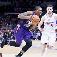 08 December 2014: Phoenix Suns guard Eric Bledsoe (2) drives past Los Angeles Clippers guard J.J. Redick (4) during the Los Angeles Clippers 121-120 overtime victory over the Phoenix Suns, at the Staples Center, Los Angeles, California, USA.