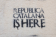Republica Catalana is Here: Pro-Catalan independence graffiti stencil on the wall of Biblioteca Central Gabriel Ferrater (municipal library), Sant Cugat del Valles, Barcelona, Catalonia.