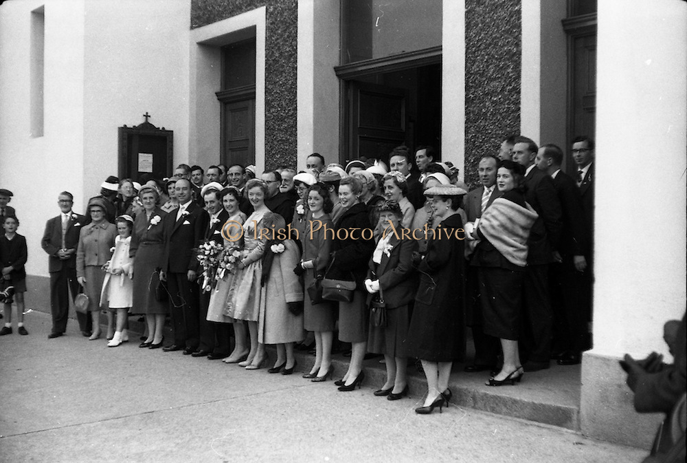 08/10/1959<br /> 10/08/1959<br /> 08 October 1959<br /> Wedding:Kenny - Colgan  (Muriel? and Tommy) at Church of St. Vincent de Paul, Griffith Avenue and the Grand Hotel, Malahide, Dublin. The wedding party pose for a photo  outside the church after the wedding service.