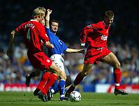 Photo Aidan Ellis.<br />Everton v Liverpool.<br />FA Barclaycard Premiership.<br />30/08/2003.<br />Everton's Thomas Radzinski and Liverpool's Sami Hyypia and Steven Gerrard
