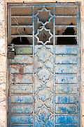 Old rusty blue iron door
