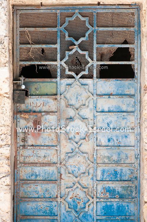 Old rusty blue iron door