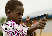 A boy plays with a sling shot outside the Kotonli kindergarten in the village of Kotonli, northern Ghana, on Thursday June 7, 2007.