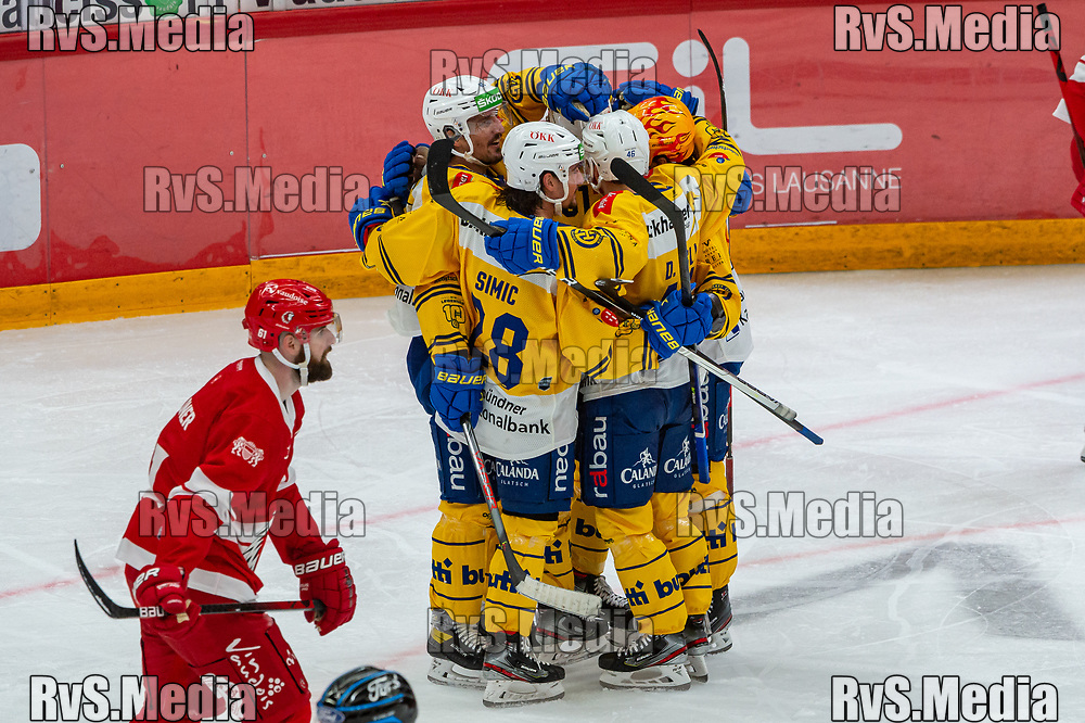 LAUSANNE, SWITZERLAND - SEPTEMBER 24: Raphael Prassl #81 of HC Davos celebrates his goal with teammates during the Swiss National League game between Lausanne HC and HC Davos at Vaudoise Arena on September 24, 2021 in Lausanne, Switzerland. (Photo by Robert Hradil/RvS.Media)
