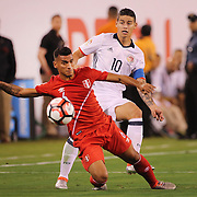 EAST RUTHERFORD, NEW JERSEY - JUNE 17:  Miguel Trauco #6 of Peru is challenged by James Rodriguez #10 of Colombia during the Colombia Vs Peru Quarterfinal match of the Copa America Centenario USA 2016 Tournament at MetLife Stadium on June 17, 2016 in East Rutherford, New Jersey. (Photo by Tim Clayton/Corbis via Getty Images)