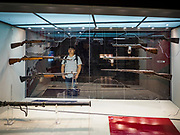 08 JUNE 2018 - SEOUL, SOUTH KOREA: A teenager looks at a display of US and Soviet bloc small arms at the War Memorial of Korea in Seoul, South Korea. With the near constant threat of invasion from North Korea, many South Koreans take great pride in the ability of their armed forces. Some observers believe there is a possibility that a peace agreement between South and North Korea could be signed following the Trump/Kim summit in Singapore. The War Memorial and museum opened in 1994 on the former site of the army headquarters to exhibit and memorialize the military history of Korea. When it opened in 1994 it was the largest building of its kind in the world. The museum features displays about the Korean War and many static displays of military equipment.    PHOTO BY JACK KURTZ