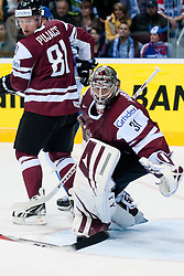 Edgars Masalskis, goalie of Latvia watches the puck deflected of the stick during ice-hockey match between Latvia and Finland of Group D of IIHF 2011 World Championship Slovakia, on May 2, 2011 in Orange Arena, Bratislava, Slovakia. (Photo by Matic Klansek Velej / Sportida)