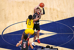 Jan 25, 2021; Morgantown, West Virginia, USA; West Virginia Mountaineers guard Kedrian Johnson (0) pressures Texas Tech Red Raiders guard Mac McClung (0) during the second half at WVU Coliseum. Mandatory Credit: Ben Queen-USA TODAY Sports