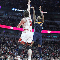 26 March 2012: Denver Nuggets small forward Wilson Chandler (21) takes a jumpshot over Chicago Bulls center Omer Asik (3) during the Denver Nuggets 108-91 victory over the Chicago Bulls at the United Center, Chicago, Illinois, USA. NOTE TO USER: User expressly acknowledges and agrees that, by downloading and or using this photograph, User is consenting to the terms and conditions of the Getty Images License Agreement. Mandatory Credit: 2012 NBAE (Photo by Chris Elise/NBAE via Getty Images)