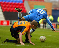 Photo: Chris Brunskill. Wigan Athletic v Milwall. Coca-Cola Championship. 12/03/2005. Tony Craig of Milwall brings down Gary Teale of Wigan for a penalty.