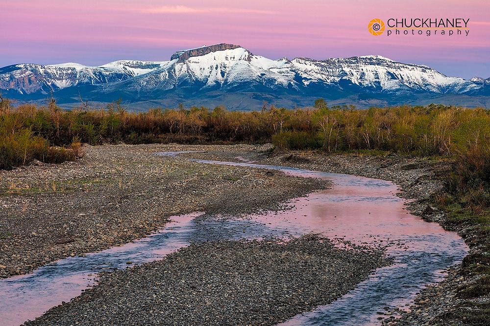 Dawn along the Teton River with Ear Mountain in background near Choteau, Montana, USA