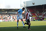 Bradford's Rory McArdle heads the ball . Skybet football league one match , Brentford v Bradford City at Griffin Park in Brentford, London  on Saturday 8th March 2014.<br /> pic by John Fletcher, Andrew Orchard sports photography.
