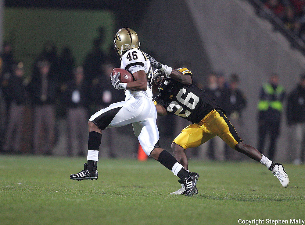 17 NOVEMBER 2007: Iowa wide receiver Paul Chaney (26) tries bring down Western Michigan safety Desman Stephen (46) after he intercepts a pass in Western Michigan's 28-19 win over Iowa at Kinnick Stadium in Iowa City, Iowa on November 17, 2007.