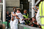 Jordan Ayew of Swansea city © celebrates with Tammy Abraham (l) and a Swansea fan after he scores his teams 2nd goal. <br /> Premier League match, Crystal Palace v Swansea city at Selhurst Park in London on Saturday 26th August 2017.<br /> pic by Kieran Clarke, Andrew Orchard sports photography.