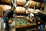 Winery workers playing fooseball while on break during harvest at Terra Valentine Winery, St. Helena, California