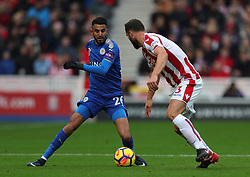 Leicester City's Riyad Mahrez (left) and Stoke City's Erik Pieters battle for the ball during the Premier League match at the bet365 Stadium, Stoke-on-Trent.