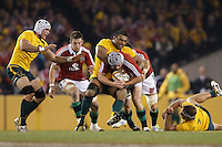 MELBOURNE, 29 JUNE - Jonathan DAVIES of the Lions is tackled by Wycliff PALU of the Wallabies during the Second Test match between the Australian Wallabies and the British & Irish Lions at Etihad Stadium on 29 June 2013 in Melbourne, Australia. (Photo Sydney Low / asteriskimages.com)