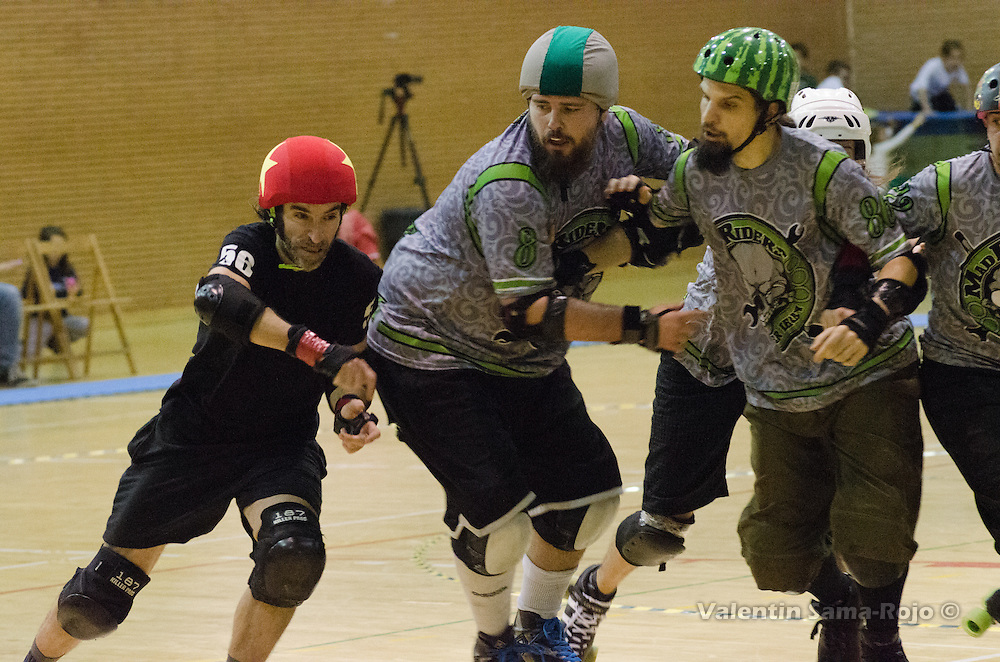 MADRID, SPAIN - January 23, 2016: Jammer of RockNRollaz, 56 Pere Ballari, trying to pass the defensive wall of MadRiders during the match held in Madrid.