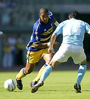 Roma 21/9/2003<br />Lazio Parma<br />Adriano (Parma) challenged by Stefano Fiore (Lazio)<br /><br />Foto Graffiti