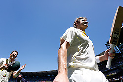 © Licensed to London News Pictures. 29/12/2013. Shane Watson walk off the field raising his bat after Australia beat England during Day 4 of the Ashes Boxing Day Test Match between Australia Vs England at the MCG on 29 December, 2013 in Melbourne, Australia. Photo credit : Asanka Brendon Ratnayake/LNP