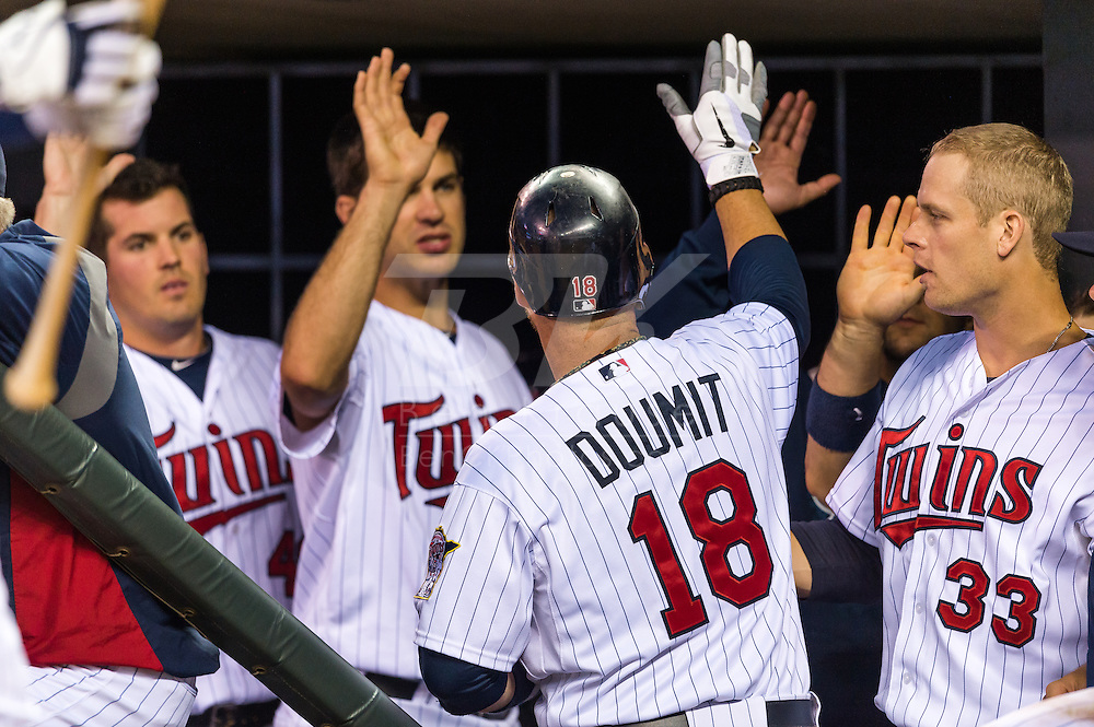 Ryan Doumit (18) of the Minnesota Twins is congratulated in the dugout after hitting a home run during a game against the Tampa Bay Rays on August 10, 2012 at Target Field in Minneapolis, Minnesota.  The Rays defeated the Twins 12 to 6.  Photo: Ben Krause