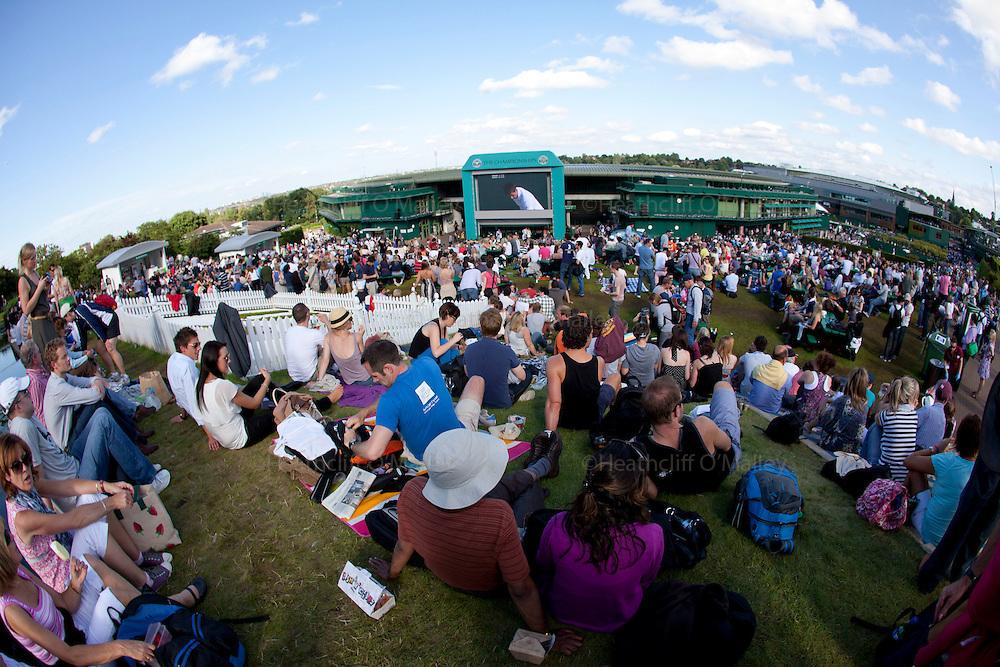 Mcc0032212 . SundayTelegraph..Spectators enjoy the tennis and sunshine on Henman Hill...The sixth day of The Lawn Tennis Championships at Wimbledon..24 June 2011 Wimbledon