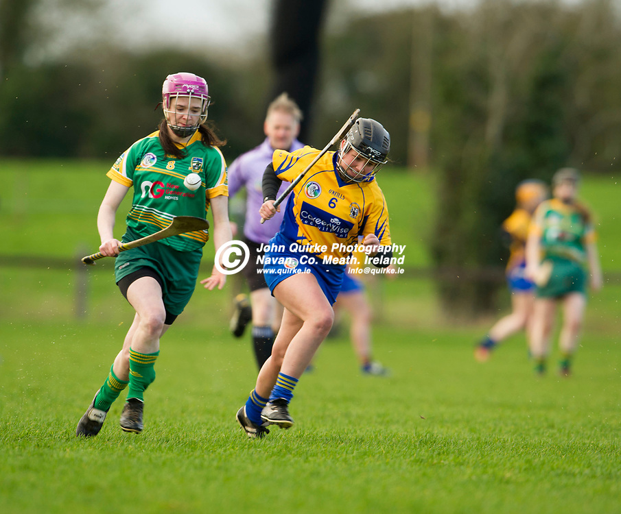 26-02-17. Meath v Clare - Littlewoods Ireland National Camogie League Division 1 Group 2 at Kilcloon.<br /> Katie Hackett, Meath on a solo run with Orlaith Duggan, Clare in persuit.<br /> Photo: John Quirke / www.quirke.ie<br /> ©John Quirke Photography, Unit 17, Blackcastle Shopping Cte. Navan. Co. Meath. 046-9079044 / 087-2579454.
