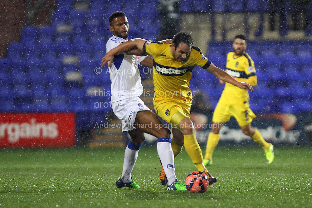 Michael Ihiekwe of Tranmere Rovers looks to tackle Danny Hylton  of Oxford United. The FA Cup, 2nd round replay, Tranmere Rovers v Oxford United at Prenton Park in Birkenhead, England on Tuesday 16th December 2014.<br /> pic by Chris Stading, Andrew Orchard sports photography.