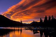 Lenticular wave cloud at sunset over an alpine tarn at Tioga Pass, Yosemite National Park, CALIFORNIA