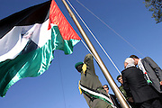 Mahmoud Abbas raising the Palestinian flag during the celebrations marking the first anniversary of the loss of former Palestinian leader Yasser Arafat at the Palestinian Authority (PA) headquarter, last residence and burial site of Yasser Arafat, in the Palestinian capital Ramallah, on Friday, Nov. 11, 2005. Here a mausoleum and a museum in his honour will be built soon. **ITALY OUT**