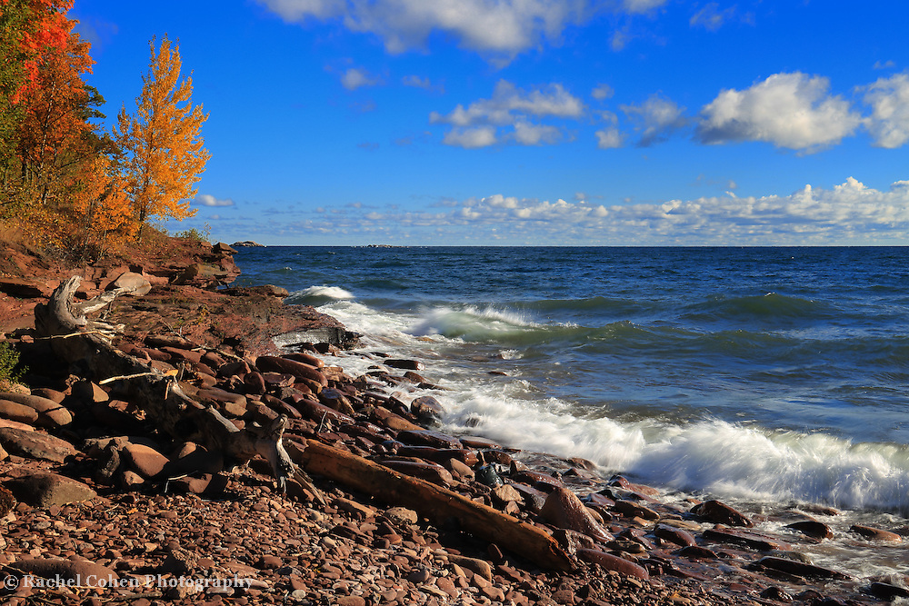 """""""Red Stones and Waves"""" <br /> <br /> Such a gorgeous day on at Presque Isle Park! Colorful fall trees, blue skies, waves on Lake Superior, and beautiful red hued stones on the shore!"""