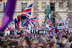 © Licensed to London News Pictures. 29/03/2019. Supporters of the Leave campaign sing and wave flags during a Leave Means Leave demonstration taking place in Westminster on the day that Britain was originally due to leave the European Union. MPs today rejected Theresa May's withdrawal deal for the third time. Photo credit : Tom Nicholson/LNP
