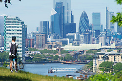 ©Licensed to London News Pictures 19/05/2020  <br /> Greenwich, UK. A sunny view across London. Warm sunny weather in Greenwich park, Greenwich, London today as people get out of the house from coronavirus lockdown to relax, sunbathe or walk in the park. Photo credit:Grant Falvey/LNP