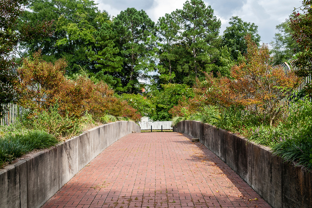 Pedestrian bridge crossing U.S. Highway 401 between Arsenal Park and the Museum of the Cape Fear in Fayetteville, North Carolina on Sunday, August 15, 2021. Copyright 2021 Jason Barnette