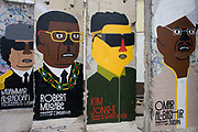 "World dictators adorn old sections of the old Berlin Wall <br /> opposite the former Checkpoint Charlie, the former border between Communist East and West Berlin during the Cold War. The Berlin Wall was a barrier constructed by the German Democratic Republic (GDR, East Germany) starting on 13 August 1961, that completely cut off (by land) West Berlin from surrounding East Germany and from East Berlin. The Eastern Bloc claimed that the wall was erected to protect its population from fascist elements conspiring to prevent the ""will of the people"" in building a socialist state in East Germany. In practice, the Wall served to prevent the massive emigration and defection that marked Germany and the communist Eastern Bloc during the post-World War II period."