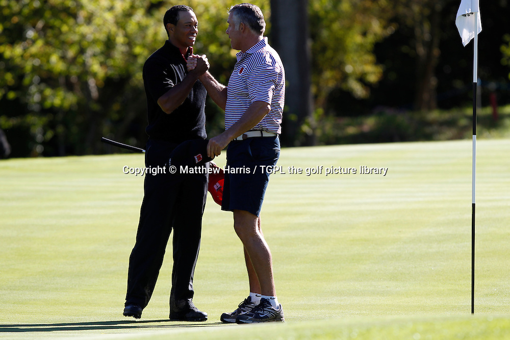 Tiger WOODS (USA) wins his match 4 and 3 V Francesco MOLINARI (EUR) celebrates with his NZ caddie Steve Williams Session Four_Singles during Ryder Cup 2010,Celtic Manor,Newport,Wales.