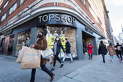 © Licensed to London News Pictures. 05/12/2020. LONDON, UK.  Shoppers pass a branch of Top Shop in Oxford Street on the first Saturday after lockdown restrictions were lifted on 2 December.  Retailers are hoping that physical sales will pick up in the run up to Christmas.  This comes against a backdrop of two major retailers Debenhams and Arcadia, owner of Topshop, collapsing into administration in the last week.  Photo credit: Stephen Chung/LNP