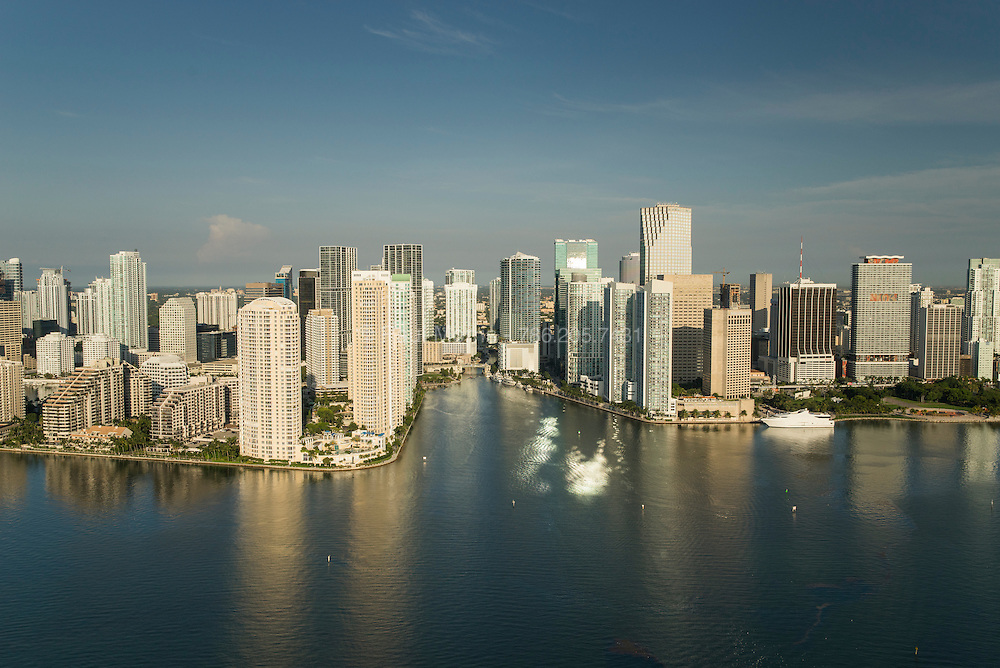 Downtown Miami looking up the mouth of the Miami River at sunrise, looking west.