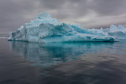An iceberg mirrors in the water of the Herrera Chanel, Antarctica, on January 31, 2020.