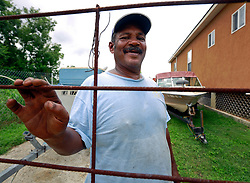 23 August 2013. Lower 9th Ward, New Orleans, Louisiana.<br /> Katrina 8 years later. Local resident Bobbie Payne complains of limited services, infrequent police patrols, high crime rates, rampant mosquitos and uncontrolled vermin. <br /> In a tale of two cities, the hardest hit neighbourhoods struggle to revitalize and return. Many half finished or blighted properties and vacant overgrown lots remain dotted throughout the landscape with limited new construction projects. <br /> Photo; Charlie Varley