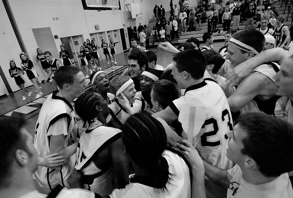 Teammates, fans, friends, and family rush the court  after Jason's (far left) heroic performance.